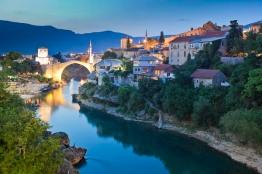 Stari Most or Old Bridge over Neretva River at dusk.